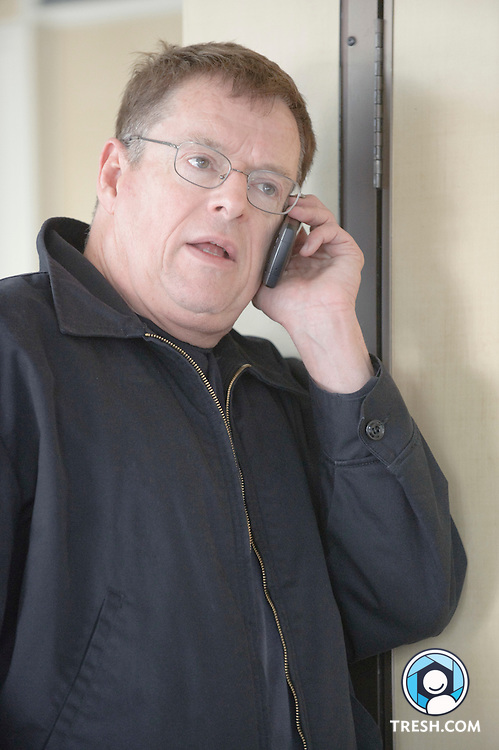 Activist Cleve Jones talks on a mobile phone prior to the morning press conference for the National Equality March, Friday, October 9, 2009, in Washington, DC.