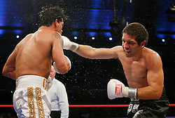 July 14, 2007; Atlantic City, NJ, USA; Arturo Gatti and Alfonso Gomez trade punches during their 10 round bout at Boardwalk Hall in Atlantic City, NJ.  Gomez won via 7th round stoppage.
