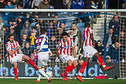 Josh Scowen (Queens Park Rangers) attempt at goal saved by Joe Allen (Stoke) during the EFL Sky Bet Championship match between Queens Park Rangers and Stoke City at the Loftus Road Stadium, London, England on 9 March 2019.