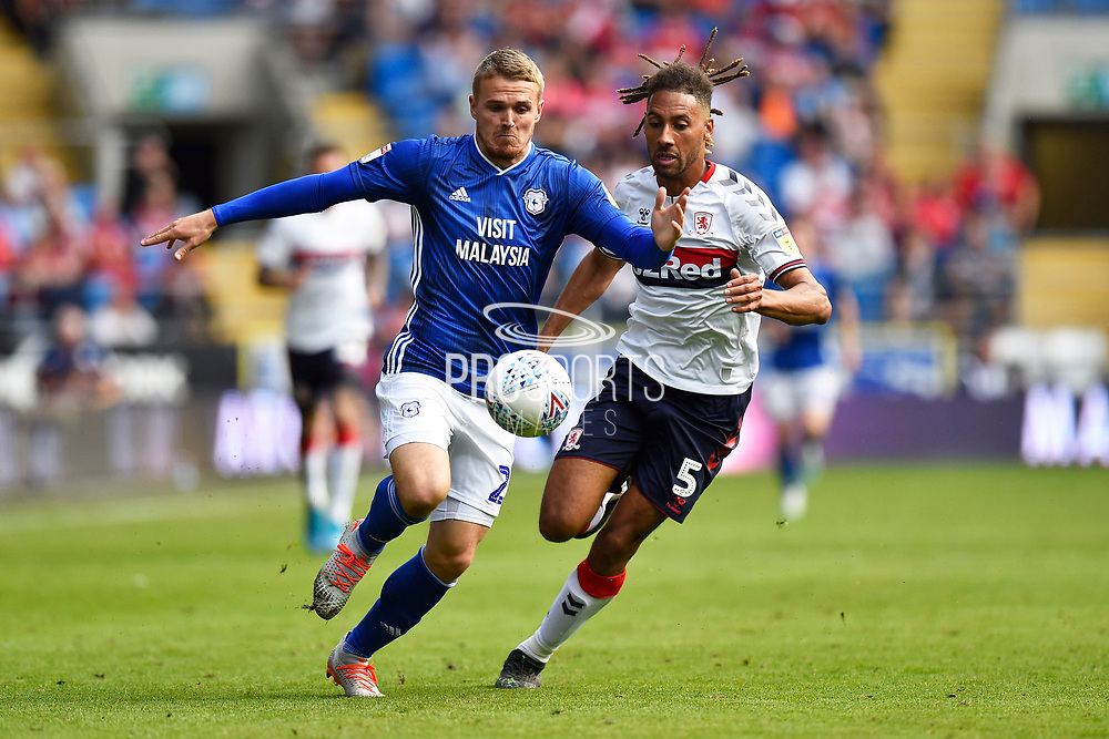 Danny Ward (23) of Cardiff City on the attack chased by Ryan Shotton (5) of Middlesbrough during the EFL Sky Bet Championship match between Cardiff City and Middlesbrough at the Cardiff City Stadium, Cardiff, Wales on 21 September 2019.