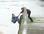 UKIP 2015 Spring Conference at the Winter Gardens Margate, Great Britain <br /> 28th February 2015 <br /> <br /> <br /> Sam Gould <br /> UKIP PPC Caerphily <br /> writing a message to Nigel Farage on the beach outside the conference venue. <br /> <br /> pulled up by Gawain Towler <br /> <br /> Photograph by Elliott Franks <br /> Image licensed to Elliott Franks Photography Services