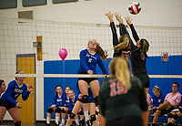Winnisquam's Gabby Isabelle powers off a spike through Moultonboro blockers Mikayla Galipeault and Jessica Lear during NHIAA Division III volleyball Monday evening.  (Karen Bobotas/for the Laconia Daily Sun)