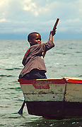 Africa. Lake Malawi. Young boy rowing boat..CD0010