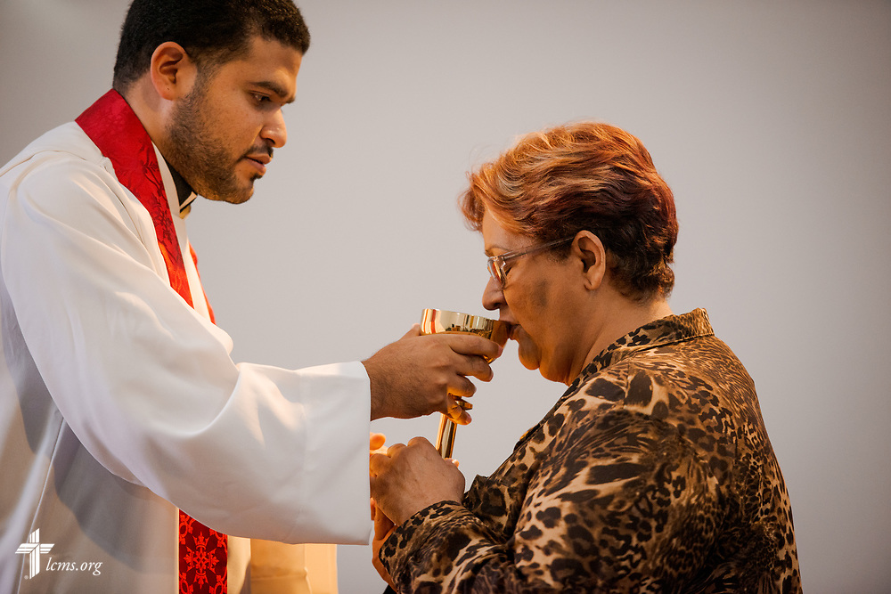 The Rev. Gustavo Maita, pastor of Iglesia Luterana Principe de Paz (Prince of Peace Lutheran Church), Mayagüez, Puerto Rico, distributes the Sacrament to Sylvia Gonzalez, a newly confirmed member of the congregation, during worship on Sunday, April 15, 2018. LCMS Communications/Erik M. Lunsford