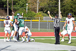 01 October 2016:  Austin Wagner bobbles but controls a pass before going to the turf in the endzone and scoring 6 points during an NCAA division 3 football game between the Wheaton Thunder and the Illinois Wesleyan Titans in Tucci Stadium on Wilder Field, Bloomington IL (Photo by Alan Look)