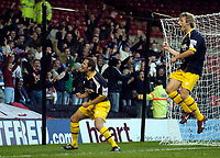 Photo: Jed Wee.<br />Nottingham Forest v Weymouth. The FA Cup.<br />05/11/2005.<br />Weymouth's Andrew Harris (L) celebrates his equaliser with the fans and Lee Elam.