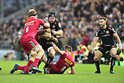 Thomas Waldrom of Exeter Chiefs charges farward as James Chisholm of Harlequins and Jono Kitto of Harlequins attempt to stop him during the Aviva Premiership match between Exeter Chiefs and Harlequins at Sandy Park, Exeter, United Kingdom on 19 November 2017. Photo by Graham Hunt.