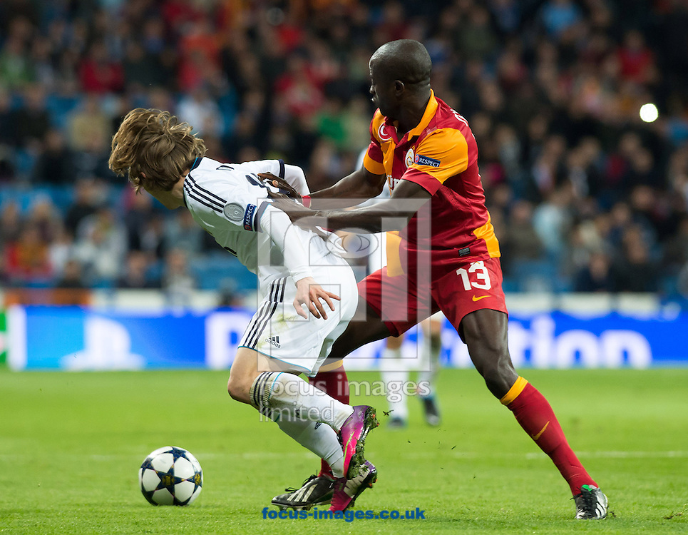 Picture by Sam Wordley/Focus Images Ltd +34 605 350 422.03/04/2013.Luka Modric of Real Madrid and Dany Nounkeu of Galatasaray during the UEFA Champions League match at the Estadio Santiago Bernabéu, Madrid.
