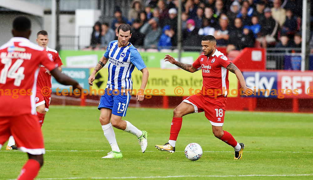 Pascal Gross of Brighton (left) with Billy Clifford of Crawley during the Friendly match between Crawley Town and Brighton and Hove Albion at the Checkatrade Stadium in Crawley. 22 Jul 2017