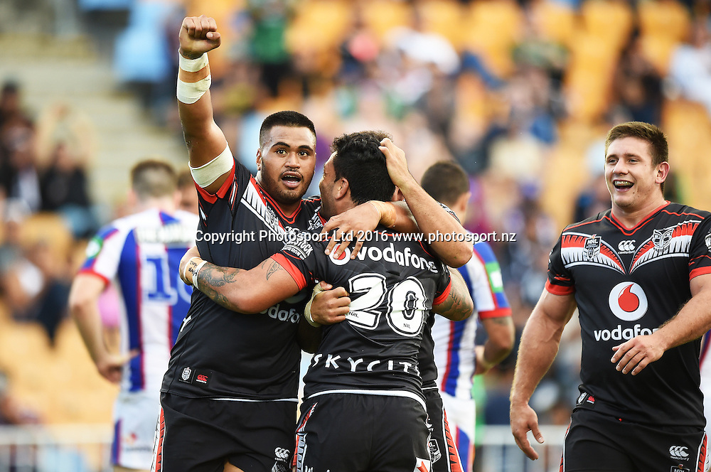 Issac Luke celebrates his try with Sam Lisone and Jazz Tevaga as Jacob Lillyman looks on during the NRL Rugby League match. Vodafone Warriors v Knights, Mt Smart Stadium, Auckland, New Zealand. Easter Monday, 28 March 2016. Copyright Photo: Andrew Cornaga / www.Photosport.nz