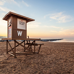 Newport Beach Wedge Lifeguard Stand W and Newport Jetty at sunrise. The wedge lifeguard station and jetty are a popular surfing spot in Orange County Southern California in the United States of America. Photo Copyright ⓒ 2010 Paul Velgos with All Rights Reserved.