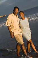 Couple walking at ocean (portrait)