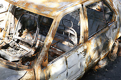 Remains of a burnt out car,