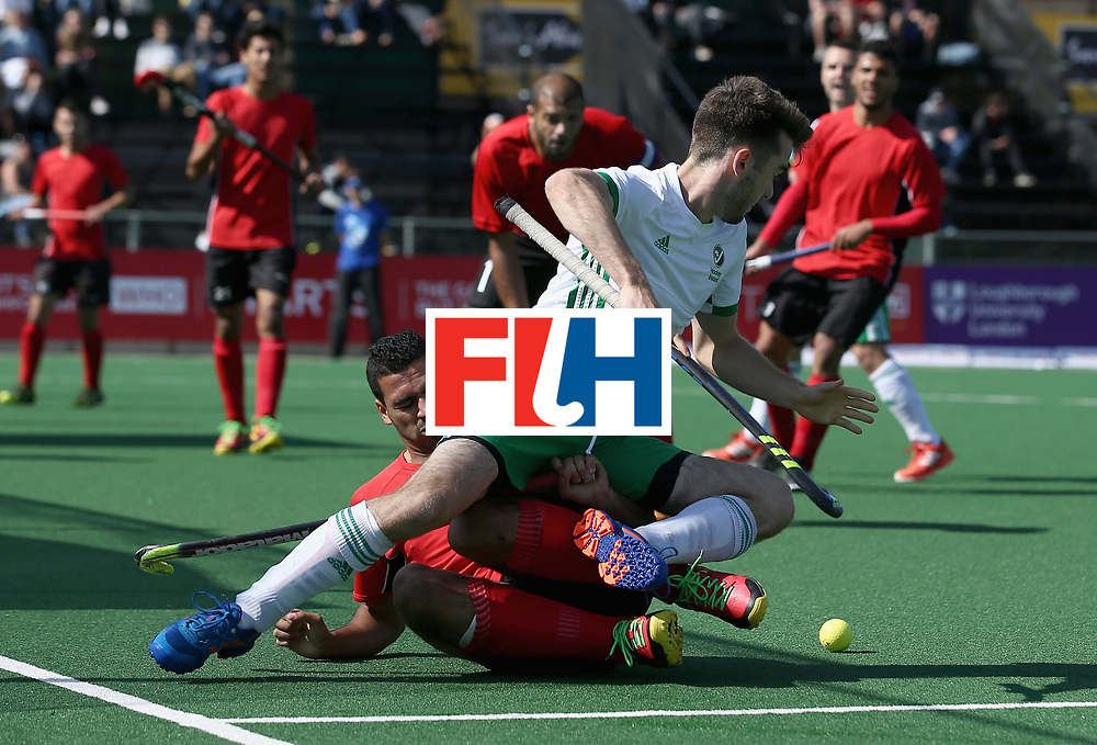 JOHANNESBURG, SOUTH AFRICA - JULY 13: John McKee of Ireland and Mohamed zaki of Egypt battle for possession during day 3 of the FIH Hockey World League Semi Finals Pool B match between Ireland and Egypt at Wits University on July 13, 2017 in Johannesburg, South Africa. (Photo by Jan Kruger/Getty Images for FIH)