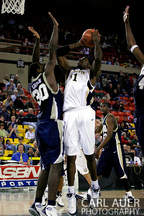 25 November 2005: Jamil Lott (51) attempts a shot for Marquette over ORU junior forward Caleb Green (30) in the Marquette University 73-70 victory over Oral Roberts University at the Great Alaska Shootout in Anchorage, Alaska
