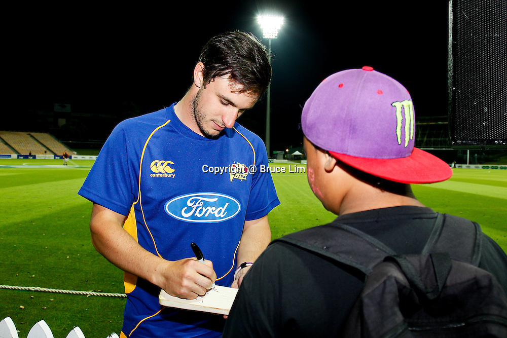 Otago Volt's Ryan ten Doeschate signs an autograph for a young fan.  HRV Cup - Northern Knights v Otago Volts at Seddon Park, Hamilton on Friday 14 December 2012.  Photo: Bruce Lim / Photosport.co.nz