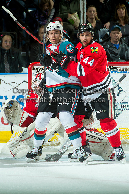 KELOWNA, CANADA - APRIL 7: Carsen Twarynski #18 of the Kelowna Rockets looks for the pass in front of the net of Cole Kehler #31 as Keoni Texeira #44 of the Portland Winterhawks checks on April 7, 2017 at Prospera Place in Kelowna, British Columbia, Canada.  (Photo by Marissa Baecker/Shoot the Breeze)  *** Local Caption ***