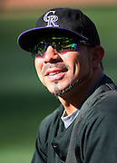 ANAHEIM, CA - JUNE 24:  Omar Quintanilla #6 of the Colorado Rockies smiles and chats as his sunglasses reflect batting practice before the game against the Los Angeles Angels of Anaheim at Angel Stadium on Wednesday, June 24, 2009 in Anaheim, California.  The Angels defeated the Rockies 11-3.  ©Paul Anthony Spinelli*** Local Caption *** Omar Quintanilla