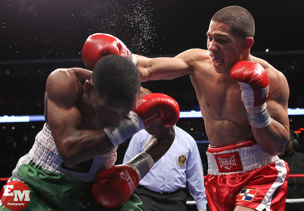 "April 9, 2011; Newark, NJ; USA; Eber Luis Perez (Green/White) and Jose ""Mangu"" Peralta (Red) during their bout at the Prudential Center in Newark, NJ.  Peralta won via 3rd round TKO."