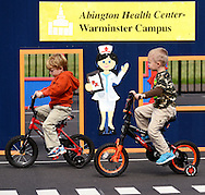 WARMINSTER, PA - OCTOBER 7: From left, Dominic Alessi, 3 and Hunter Becker, 4, both of Warminster, Pennsylvania ride bicycles at Safety Town at Warminster Community Park October 7, 2014 in Warminster, Pennsylvania. Safety Town is a miniaturized version of Warminster Township where young children can ride bikes and play in a make-believe town. The safety signs and street markings have been shrunk down to smaller size to help teach the importance of street safety.  (Photo by William Thomas Cain/Cain Images)