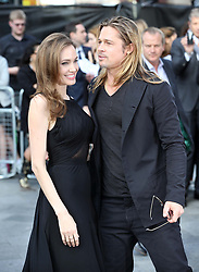 Angelina Jolie and Brad Pitt arriving for the  World War Z premiere in London, Sunday, 2nd June 2013<br /> Picture by Stephen Lock  / i-Images