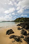 Golden sand along Bathing Beach, Stewart Island, New Zealand