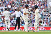 Alastair Cook of England in his final test match innings touches gloves with Moeen Ali of England during day 3 of the 5th test match of the International Test Match 2018 match between England and India at the Oval, London, United Kingdom on 9 September 2018.