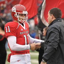 Dec 5, 2009; Piscataway, NJ, USA; Rutgers head coach Greg Schiano shakes hands with quarterback Domenic Natale during the senior ceremony before first half NCAA Big East college football action between Rutgers and West Virginia at Rutgers Stadium.