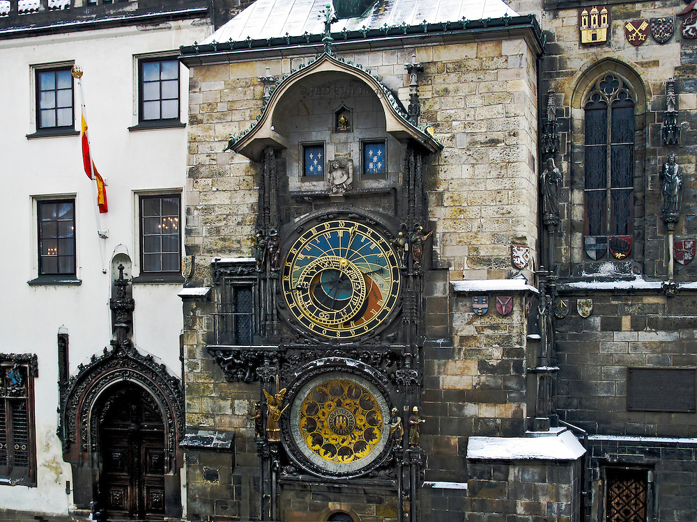 Detail of the top two thirds of the clock set into the outside wall of the Gothic town hall in Prague.   Both were bombed in World War II and afterwards by the Russians, and have since been restored.