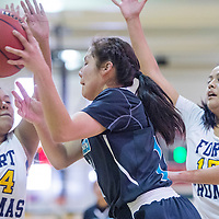 Piñon Eagle Brittany Begay (11) passes ball around the Fort Thomas Apaches Saturday at Yavapai Community College in Prescott, Ariz.