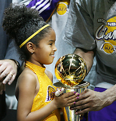 File photo dated june 14, 2009 of Kobe Bryant's daughter holds his MVP trophy after the Los Angeles Lakers won Game 5 of the NBA Finals against the Orlando Magic at Amway Arena. US basketball legend Kobe Bryant and his daughter Gianna are among nine people killed in a helicopter crash in the city of Calabasas, California. Bryant, 41, and Gianna, 13, were travelling in a private helicopter when it came down and burst into flames. Photo by Stephen M. Dowell/Orlando Sentinel/TNS/ABACAPRESS.COM