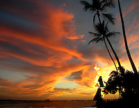 Hawaii, South Pacific.  A fiery sunset on the beach.