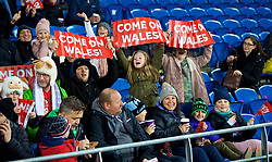 CARDIFF, WALES - Friday, November 24, 2017: Wales supporters with 'Come on Wales!' clappers before the FIFA Women's World Cup 2019 Qualifying Round Group 1 match between Wales and Kazakhstan at the Cardiff City Stadium. (Pic by David Rawcliffe/Propaganda)