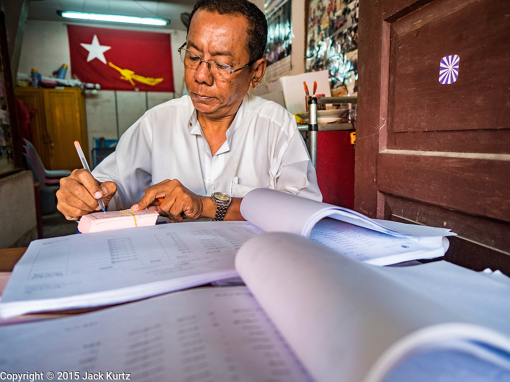 02 NOVEMBER 2015 - YANGON, MYANMAR: A NLD campaign worker reviews lists of voters at a NLD campaign outreach office in North Okkalapa, a township in Yangon. Voter registration rolls were released Monday. Voters and party officials are double checking rolls to ensure accuracy.  National elections are scheduled for Sunday Nov. 8. The two principal parties are the National League for Democracy (NLD), the party of democracy icon and Nobel Peace Prize winner Aung San Suu Kyi, and the ruling Union Solidarity and Development Party (USDP), led by incumbent President Thein Sein. There are more than 30 parties campaigning for national and local offices.     PHOTO BY JACK KURTZ