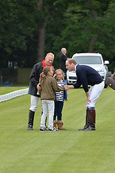HRH THE DUKE OF CAMBRIDGE talks to polo fans at the Audi Polo Challenge at Coworth Park, Blacknest Road, Ascot, Berkshire on 31st May 2015.