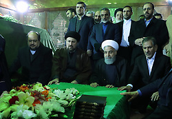 Iran's President Hassan Rowhani (R), praying over the tomb of the founder of Iran's Islamic Republic Ayatollah Ruhollah Khomeini, at the latter's shrine in southern Tehran. Rouhani said that Iran must listen to protesters behind a recent wave of unrest, hinting that it risked another revolution if their demands were ignored. Photo by Parspix/ABACAPRESS.COM