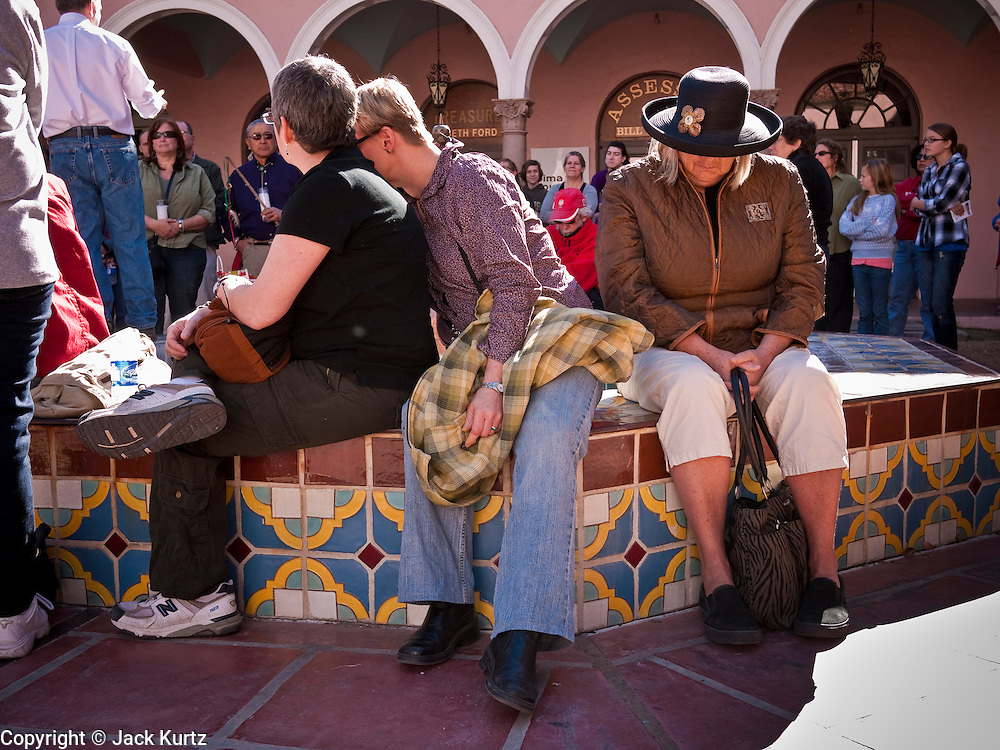 tucsonshooting - 09 JANUARY 2011 - TUCSON, AZ: People gathered in downtown Tucson Sunday to pray for Congresswoman Gabrielle Giffords and other victims of the mass shooting that took place Saturday.   ARIZONA REPUBLIC PHOTO BY JACK KURTZ