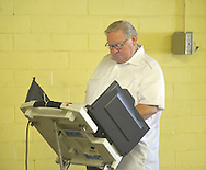 Allen Harris votes in a primary runoff election at the old National Guard Armory in Oxford, Miss. on Tuesday, August 23, 2011. (AP Photo/Oxford Eagle, Bruce Newman)