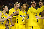 Trey Burke (3) of the University of Michigan Wolverines reacts after forcing overtime against the University of Kansas Jayhawks during the NCAA South Regionals at Cowboys Stadium in Arlington on Friday, March 29, 2013. (Cooper Neill/The Dallas Morning News)