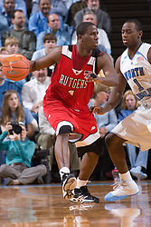 28 December 2006: Rutgers guard (1) Marquis Webb defended by guard (1) Marcus Ginyard during a 87-48 Rutgers Scarlet Knights loss to the North Carolina Tarheels, in the Dean Smith Center in Chapel Hill, NC.<br />