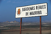 Sign over looking the barren landscape of Bardenas Reales de Navarra, Spain.