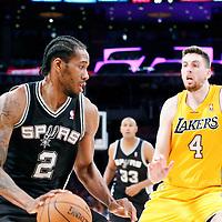 19 March 2014: San Antonio Spurs forward Kawhi Leonard (2) drives past Los Angeles Lakers forward Ryan Kelly (4) during the San Antonio Spurs 125-109 victory over the Los Angeles Lakers at the Staples Center, Los Angeles, California, USA.