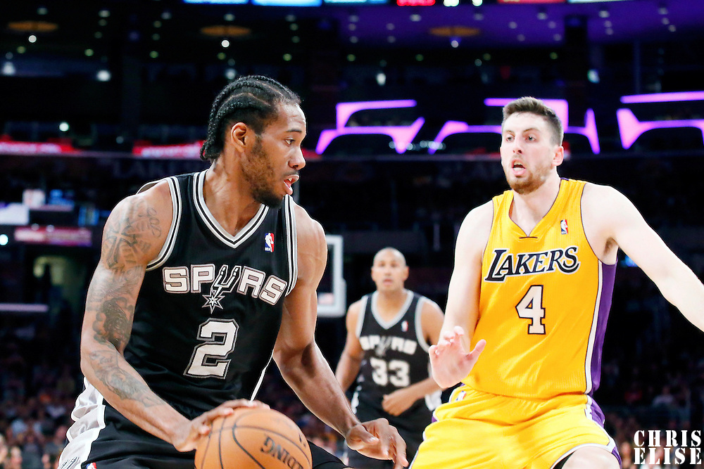 19 March 2014: San Antonio Spurs forward Kawhi Leonard (2) drives past Los Angeles Lakers forward Ryan Kelly (4) during the San Antonio Spurs 125-109 victory over the Los Angeles Lakers at the Staples Center, Los Angeles, California, USA.