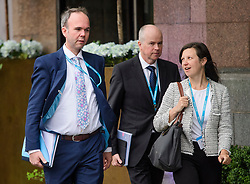 © Licensed to London News Pictures. 01/10/2017. Manchester, UK. GAVIN BARWELL (left), chief of staff to Theresa May and JONNNA PENN (right) deputy chief of staff to Theresa May, seen on the opening day of the Conservative Party Conference. There have been conflicts within the conservative party and government over the UK's approach to Brexit, which is expected to feature heavily at this years event. Photo credit: Ben Cawthra/LNP