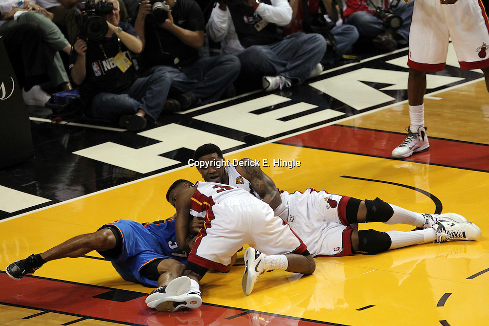 Jun 19, 2012; Miami, FL, USA; Oklahoma City Thunder point guard Derek Fisher (37) and Miami Heat point guard Norris Cole (30) and power forward Udonis Haslem (40) go for a loose ball during the second quarter in game four in the 2012 NBA Finals at the American Airlines Arena. Mandatory Credit: Derick E. Hingle-US PRESSWIRE