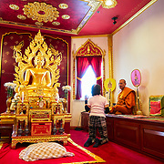 Berkeley Buddhist Temple with praying lady and monk