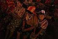 Guna indian women listening to the Sahila´s prayers and stories. Spiritual Guna General Congress, the highest political authority of Yala Guna.  . San Blas Islands, Panama. - July 22, 2012 (Kike Calvo via AP Images)