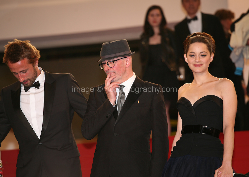 Actor Matthias Schoenaerts Director Jacques Audiard and Actress Marion Cotillard at the gala screening of the film De rouille et d'os at the 65th Cannes Film Festival. Thursday 17th May 2012, the red carpet at Palais Des Festivals in Cannes, France.