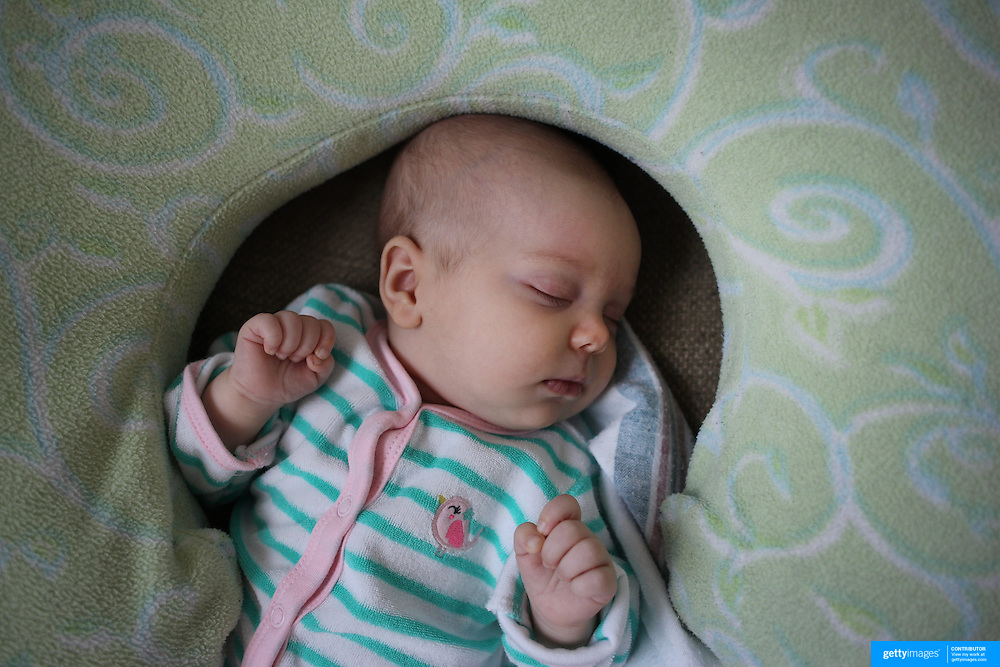 A two month old baby girl asleep. Photo Tim Clayton