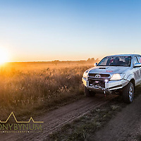 hilux toyota pickup with warn winch driving dirt road early morning sunrise in la pampa argentina